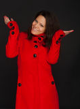 Young model wearing a red winter coat Stock Photo