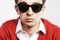 Young model wearing sunglasses. Young male model wearing sunglasses Royalty Free Stock Images