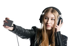 Young model in wired headphones is making selfie Stock Photo