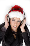 Young Model With Christmas Hat And Headphone Stock Photo
