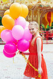 Young model woman smiling with colorful balloons Stock Photo