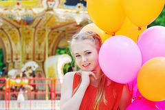 Young model woman smiling with colorful balloons Royalty Free Stock Photography
