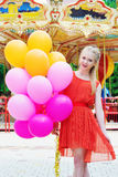 Young model woman smiling with colorful balloons royalty free stock photo