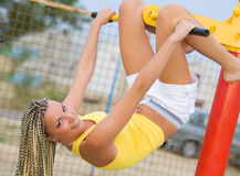 Young model working out on fitness playground Royalty Free Stock Images