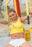 Young model working out on fitness playground Royalty Free Stock Photos