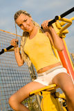 Young model working out on fitness playground Stock Photo