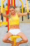 Young model working out on fitness playground Stock Photos