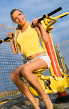 Young model working out on fitness playground Royalty Free Stock Photo