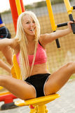 Young model working out on fitness playground Royalty Free Stock Photography