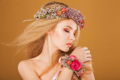 Young model with wreath of bright flowers on her Stock Photos