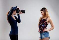 Young model with young photographer Stock Image