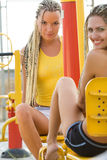 Young models working out on fitness playground Stock Photos
