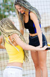 Young models working out on fitness playground Royalty Free Stock Images