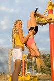 Young models working out on fitness playground Stock Images