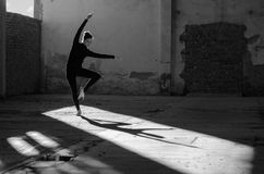 Young modern ballet dancer dancing in abandoned building Royalty Free Stock Image