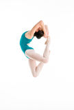 Young modern ballet dancer jumping in contemporary dance. On white background royalty free stock image