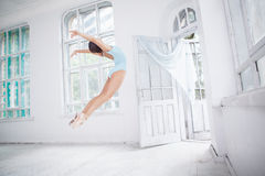 Young modern ballet dancer jumping on white Royalty Free Stock Images