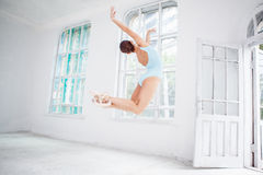 Young modern ballet dancer jumping on white Royalty Free Stock Image