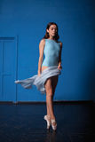 Young modern ballet dancer posing on blue Stock Image