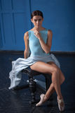 Young modern ballet dancer posing on blue Royalty Free Stock Image