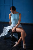 Young modern ballet dancer posing on blue Stock Photography
