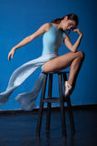 Young modern ballet dancer posing on blue Royalty Free Stock Photography