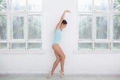 Young modern ballet dancer posing on white Stock Photo