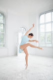 Young modern ballet dancer posing on white Royalty Free Stock Photo
