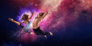 Young modern ballet dancers in a jump. Mixed media royalty free stock images