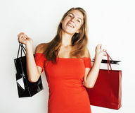 Young modern blond woman with diverse bags  posing emotional on white background, sale, lifestyle people concept Royalty Free Stock Images