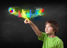 Young modern boy touching colorful modern graph system concept Royalty Free Stock Photography