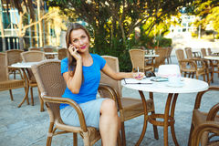 Young modern business woman talking on the phone and makes notes Stock Images