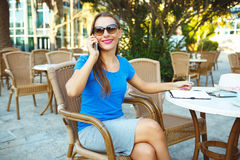 Young modern business woman talking on the phone and makes notes Stock Photography