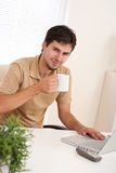 Young modern businessman with cup of coffee Stock Photos