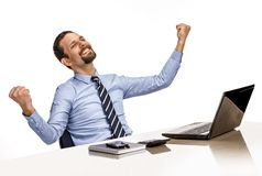 Young modern businessman excited with his success while working with his laptop computer Royalty Free Stock Image