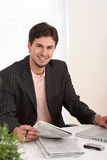 Young modern businessman with laptop Royalty Free Stock Image