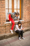 Young modern couple sharing mobile information. In the city Stock Photos
