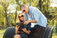 Young modern couple using digital tablet Royalty Free Stock Images