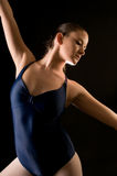 Young modern dancer. Close up of attractive young modern dancer striking a pose, in studio stock images