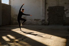 Young modern dancer dancing in abandoned building Stock Image
