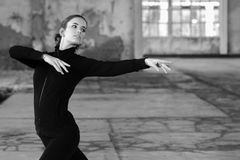 Young modern dancer exercising and dancing in abandoned building Stock Photos