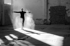 Young modern dancer exercising and dancing in abandoned building Royalty Free Stock Images