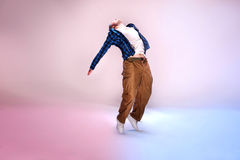 Young modern dancer. Young modern dancer jumping on studio background stock photos