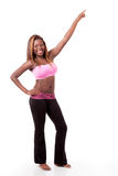 Young modern dancer pointing up. A young african-american modern dancer strikes a pose pointing up royalty free stock photo