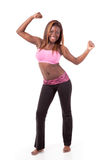 Young modern dancer striking a dance pose. A young african-american modern dancer strikes a powerful pose royalty free stock photos