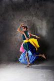 Young modern dancing girl in colorful dress Stock Photos