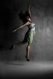 Young modern dancing girl in colorful dress Royalty Free Stock Photos