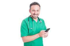 Young and modern doctor using smartphone Royalty Free Stock Images