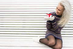 Young Modern Girl with a Gift Stock Images
