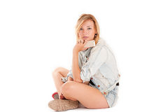 Young modern girl sitting on the floor Royalty Free Stock Photography